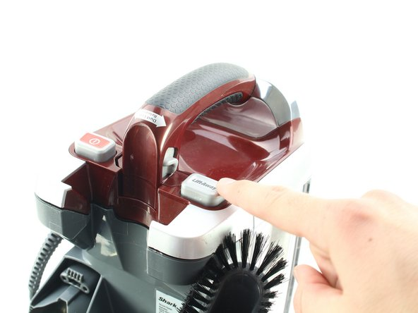 Press the Lift Away button and pull up on the handle to separate the top of the vacuum from the bottom.