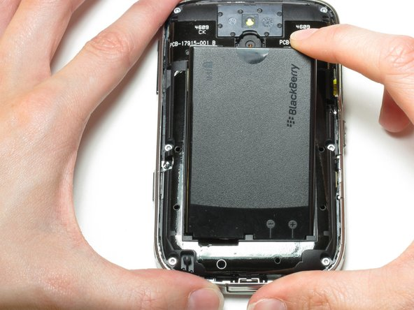 From the top, use your fingernail to lift the battery out.