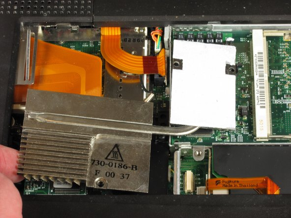 Lift up the heat sink unit from the left side and remove.