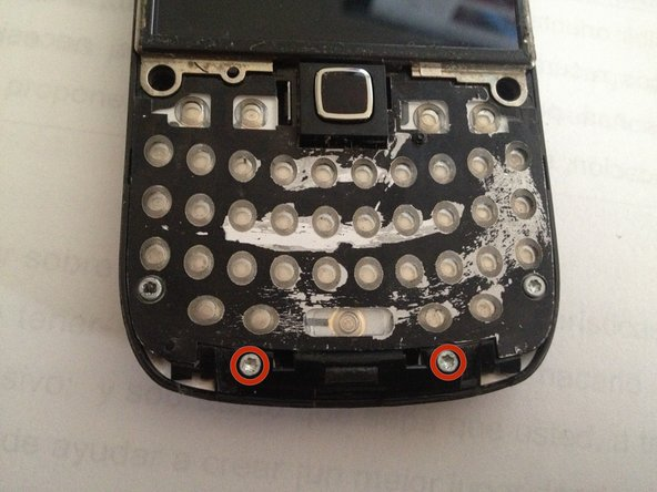 Remove the two T6 Torx screws securing the small plastic bracket at the bottom of the phone.