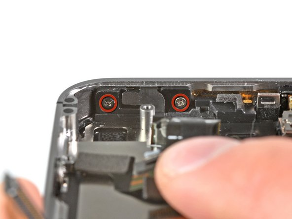 Remove the two 2.0 mm Phillips screws securing the power button bracket to the outer case.