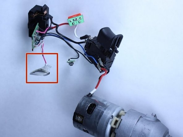 Identify the LED light. Look for the component with clear casing with two wires attached located toward the bottom of the driver.