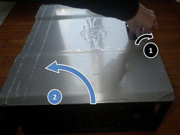 En premier tirez sur le levier puis soulevez le capot du boitier.