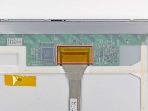 If present, remove the piece of tape covering the display data cable.