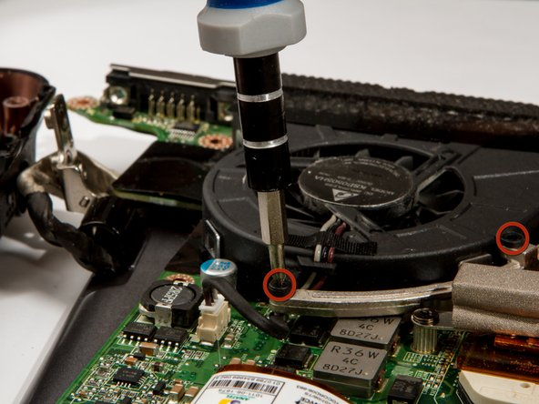 Remove the fan mounting screws with a #1 Phillips Screwdriver.