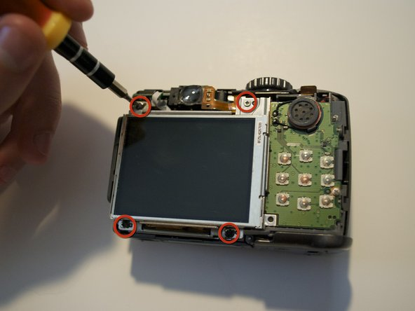 Remove the four (4) screws near the corners of the LCD.