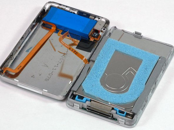 Place the rear panel next to the iPod, being careful not to strain the orange headphone jack cable.
