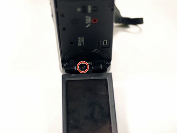 Remove the single 3 mm Phillips #00 screw from inside of the hinge of the LCD panel.