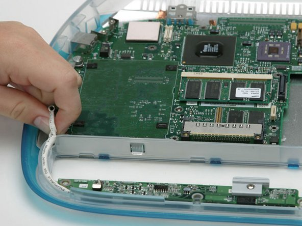 Disconnect the charger board cable from the logic board.