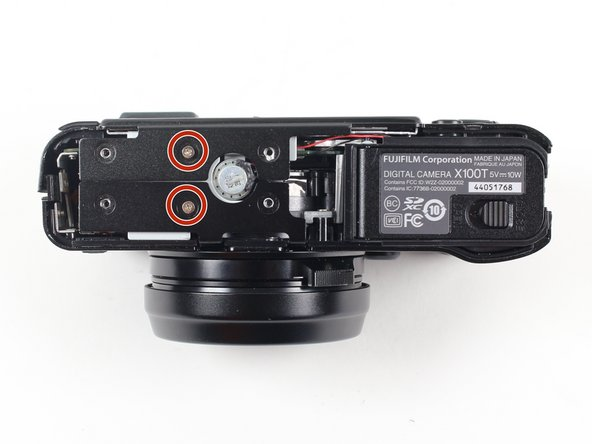 Remove the two 2.5 mm screws on the bottom face of the camera.