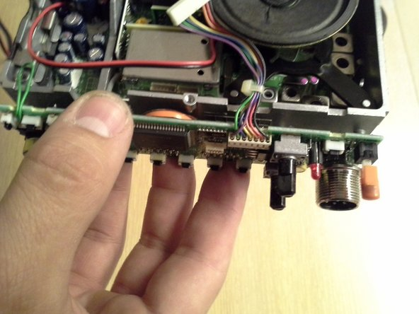Pull the control board away from the radio body.  It will be slightly more stubborn than the face plate was.