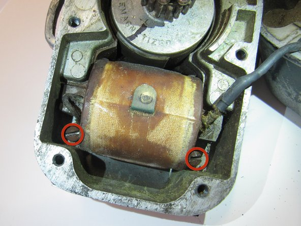 Locate the two screws on the right and left side of the primary circuit.