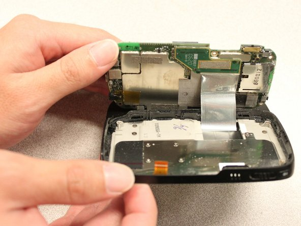 Use your hands to gently expose the underside of the motherboard.