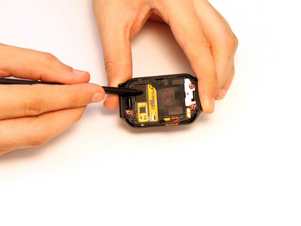 The AMOLED display is secured to the front watch assembly with adhesive in two different ways; one being an adhesive ring around the edge, and two being a small adhesive application between the display and front watch assembly.