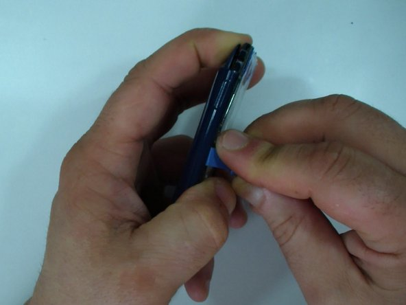 Use a plastic tool and slowly separate the back cover.