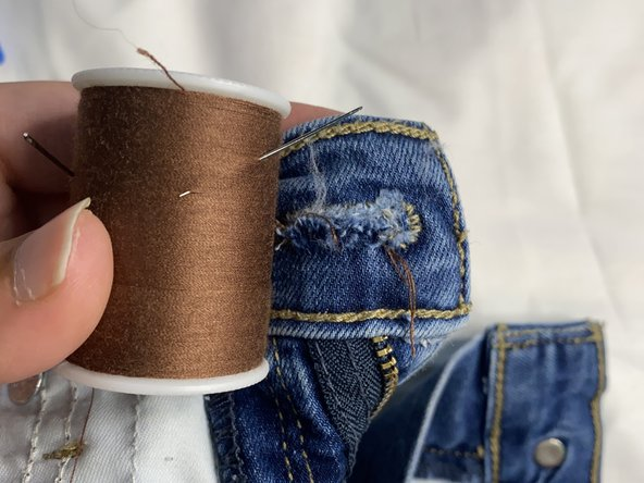 Find a thread that closely matches the thread on the pants.
