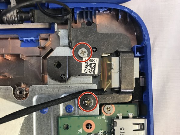 Remove the two 5mm Phillips screws from the charging port.