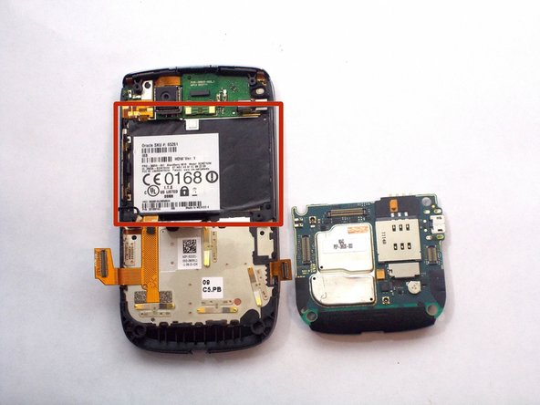 Remove the black sticker located above the logic board that contains the phone's serial number