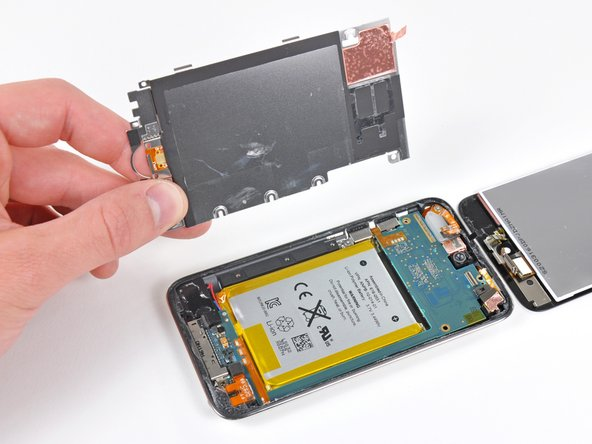 After removing the EMI shield, the battery looms large.