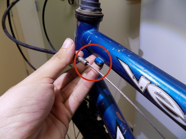 Remove the second cable housing from its holder.