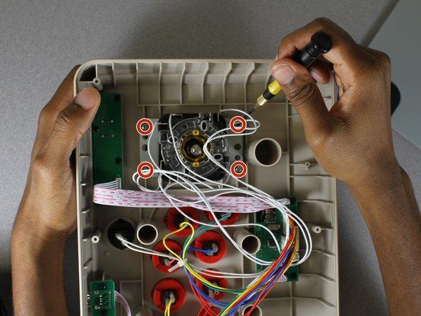 Locate the back piece of the joystick.