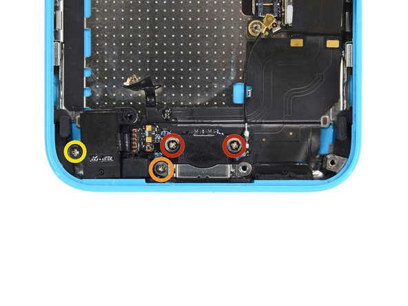 Remove the following screws securing the Lightning connector to the rear case: