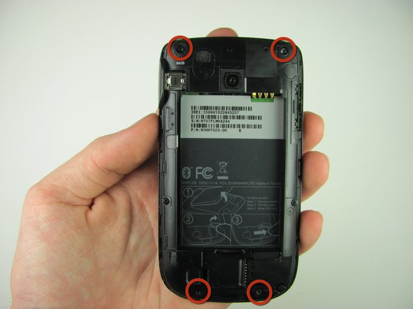 Remove the four 4.9mm T6 Torx screws that secure the back panel to the rest of the phone.