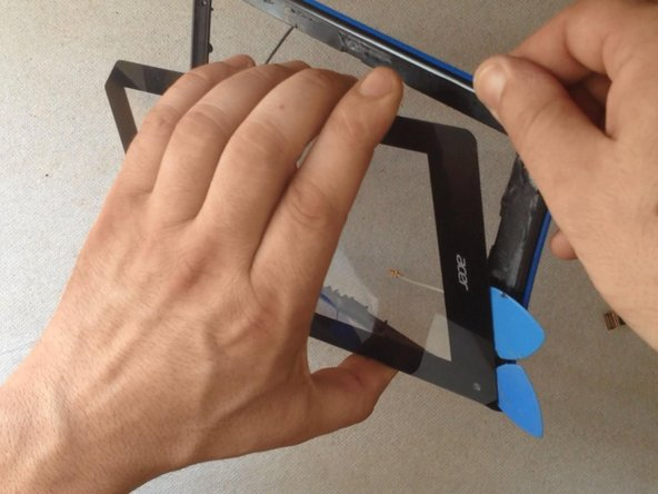Use again hot air and a plastic tools to separate the metal screen frame / holder.