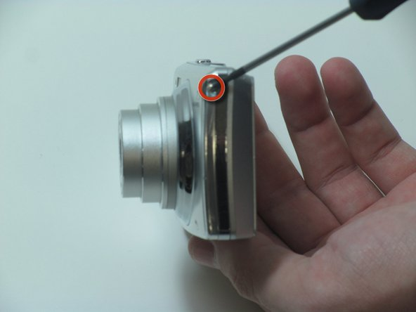 Remove the screw located on the right side of the camera