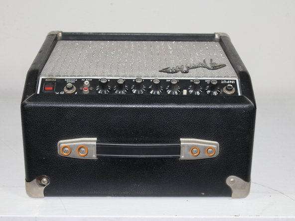 Use a Phillips #1 screwdriver to unscrew the four 36.4 mm screws holding the mounting bracket to the top of the amp.