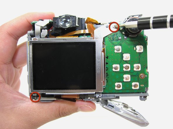 Remove two 4.35mm phillips head screws from around the LCD screen using a #00 phillips head screwdriver.