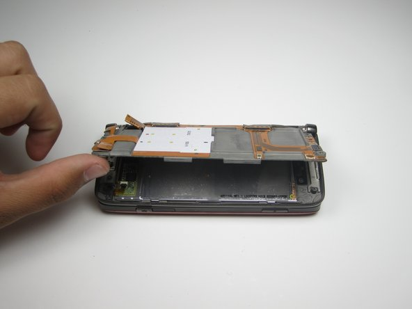 Gently, lift the board up to reveal the front screen.