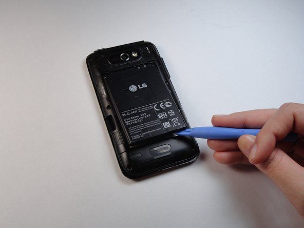 Use a plastic opening tool to remove the battery, lifting from the bottom right corner.