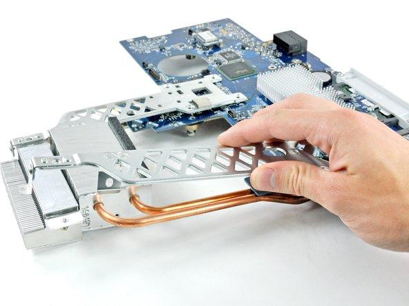 Carefully lift both metal heat sink brackets off the logic board.