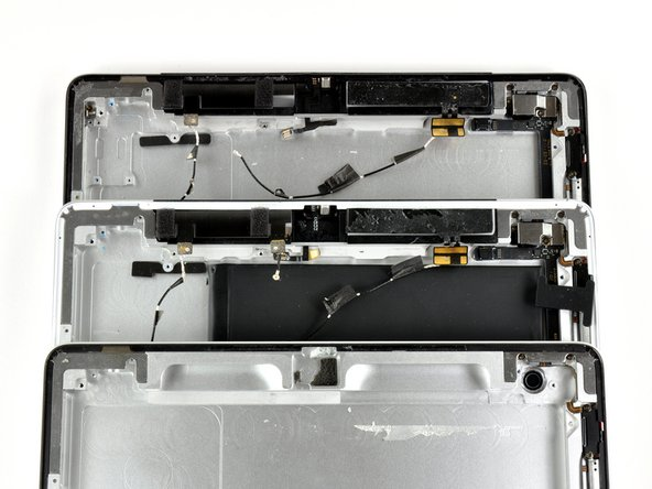 From top to bottom, a comparison of the WWAN antennas in the GSM, CDMA, and Wi-Fi versions, respectively.
