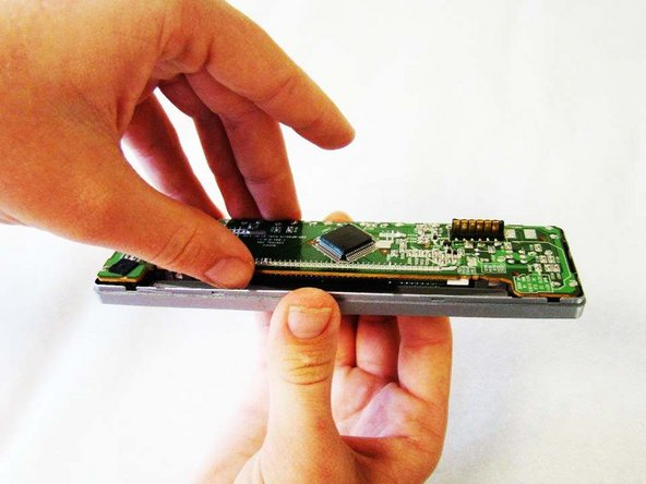 Gently grab the Front Motherboard - as indicated in the picture - and lift it from the rest of the screen.