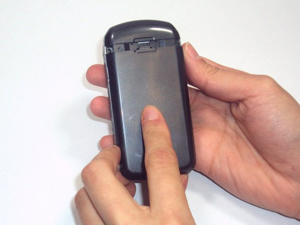 Hold your phone with the back casing facing you and the bottom of the phone towards the sky.