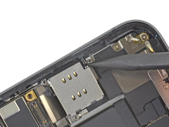 Use the point of a spudger to push the SIM eject plunger out towards the edge of the phone.