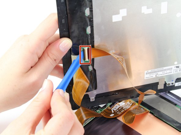Disconnect the ribbon cable by placing a plastic opening tool under the black plastic tab that is on the opposite side of the port as the ribbon cable.