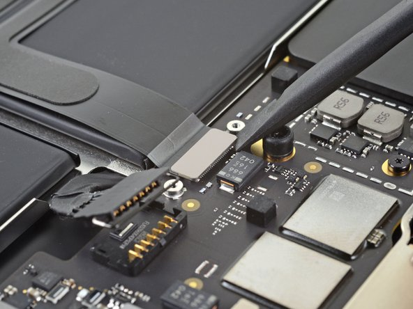 Use the flat end of a spudger to pry the trackpad cable connector up and out of its socket.
