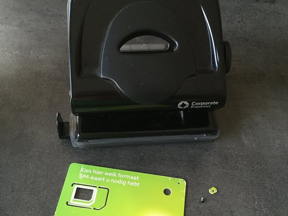 use a perforator and an old bank or sim card to cut a plastic washer.