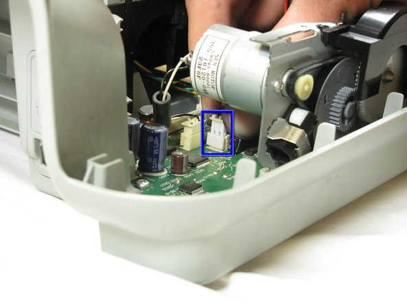 Carefully remove the connector holding the drive motor wires to the main circuit board.