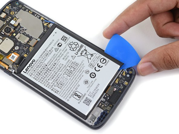 Move the pick to the bottom right corner of the battery and begin prying the right edge.