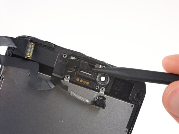 Slide the tip of a spudger underneath the proximity sensor flex cable, and lift the sensor out of its housing.