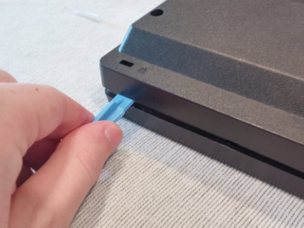 Take the edge tool or a metal ruler and insert it into bezel.