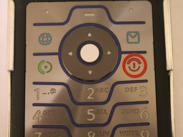 Make sure the phone is turned off by holding down the red End Call/Power button until the phone shuts off.