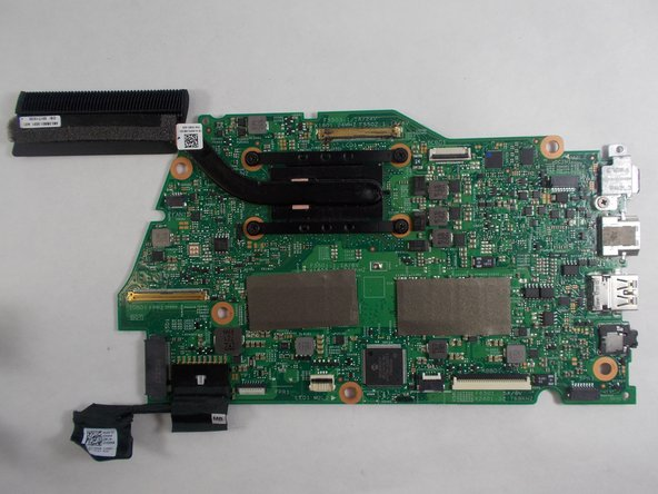 Gently lift up on the motherboard to remove it.