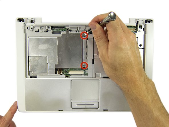 Remove the two Phillips screws securing the inner RAM cover.