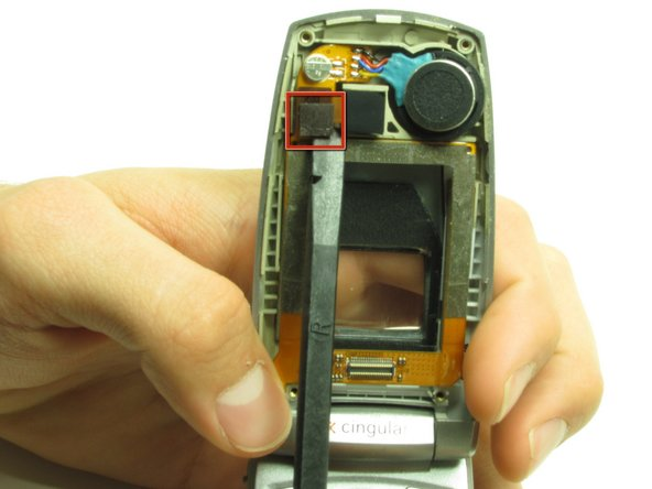 Use a spudger to pop off the camera ribbon from the main ribbon. The camera component should separate entirely.