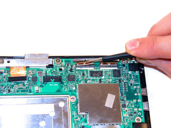Using the tweezers, gently remove the LCD connection apparatus from the LCD connection port.